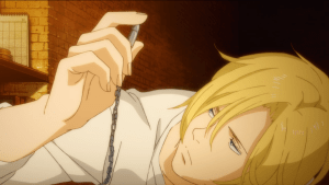 Ash looking at a bullet on a necklace