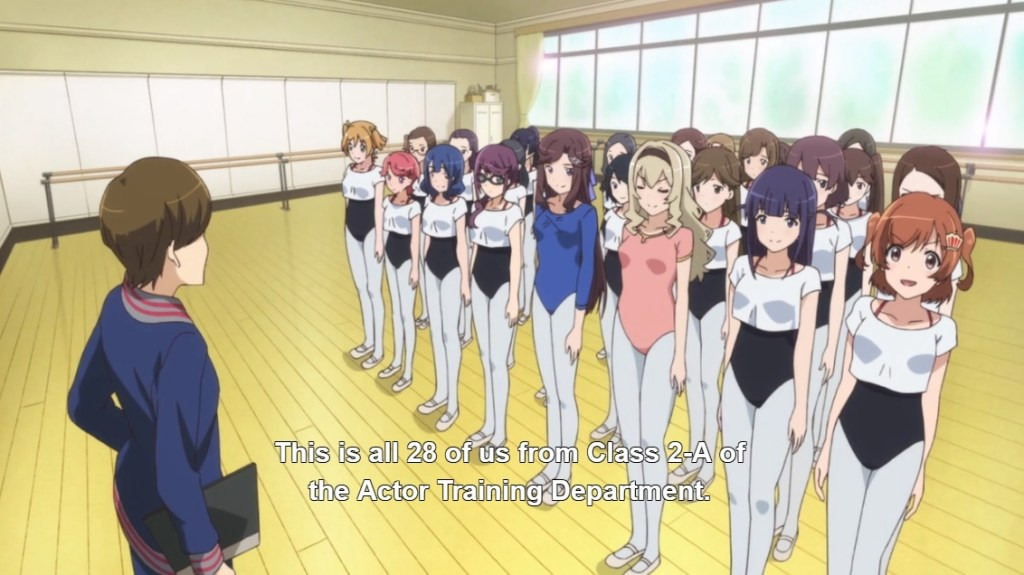 "A group of girls in dance clothes line up in front of an older woman. Subtitles read ""This is all 28 of us from Class 2-A of the Actor Training Department."""