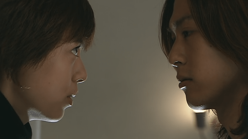 A man and a woman face each other up close