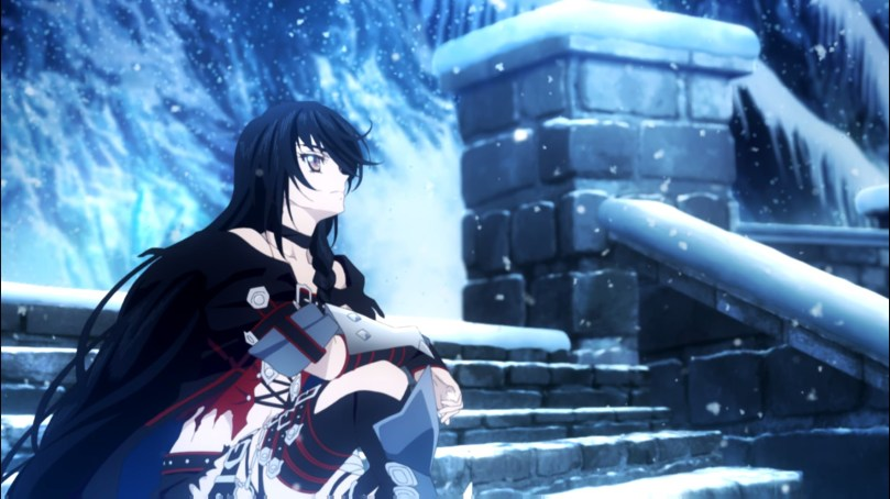 Velvet sitting on snow-covered steps on a mountainside