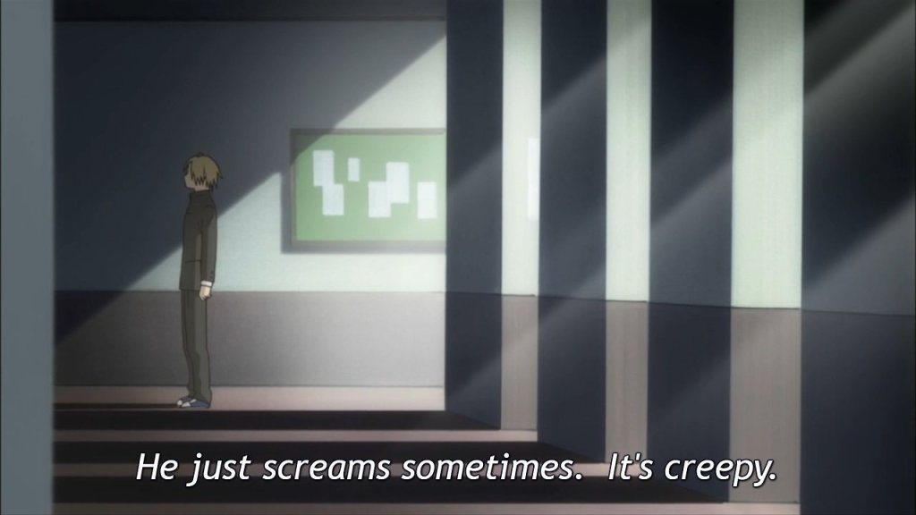"Natsume in a hallway with sun filtering through windows, shown from a distance. Subtitles read ""He just screams sometimes. It's creepy."""