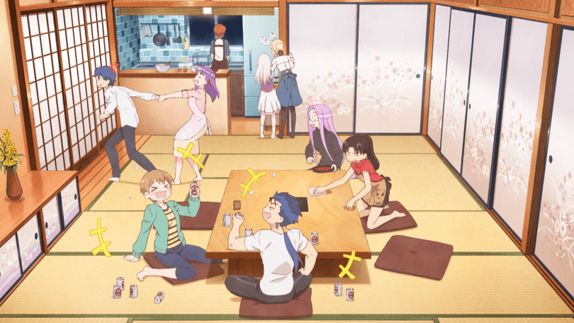 "The cast of ""Today's Menu for the Emiya Family"" gather together in a Japanese-style living room with a large table. Amidst the general merriment, Sakura is grabbing Shinji's arm, trying to keep him from leaving."
