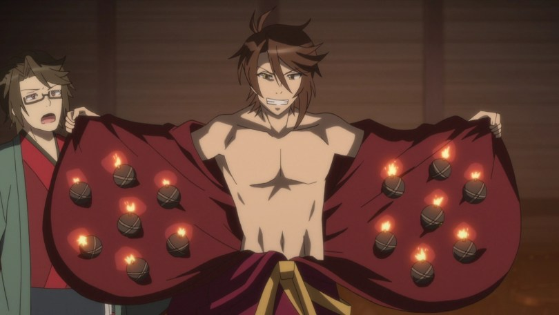 A young man pulls open his robe to reveal both abs and a bunch of tiny bombs tucked into the lining.