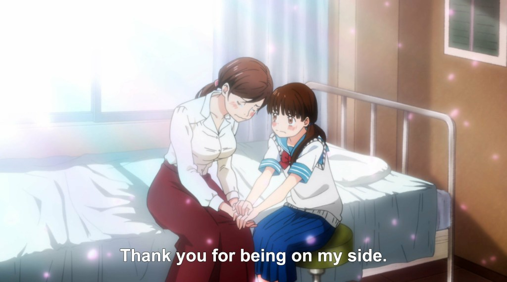 "A young girl holds the hands of an older woman as the two sit on a hospital bed together. Subtitles read ""Thank you for being on my side."""