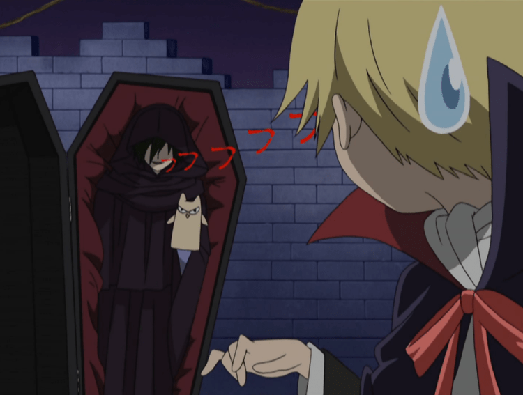 A screenshot from Ouran High. Nekozawa pops out of a coffin in a black cape, holding a cat puppet. In the foreground, Tamaki, dressed as a vampire, watches with a sweatdrop
