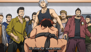"""A young man wearing a sumo loincloth shown from behind, crouching down. In front of him are a group of thugs looking freaked out. Subtitles read """"It's time for some sumo."""""""