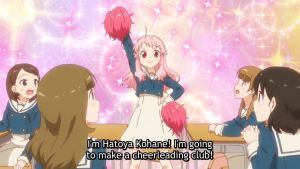 Koharu imagining introducing herself in class with pom poms. subtitle: I'm Hatoya Kohane! I'm going to make a cheerleading club!