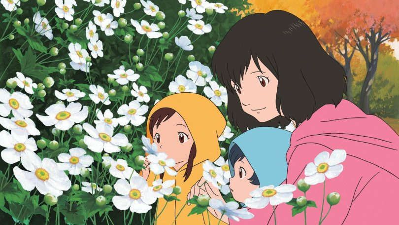 Screenshot from Wolf Children: a contented mother and her two small children, all wearing colourful raincoats, look at some flowers outside.