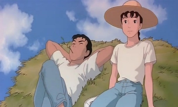Asult Taeko sitting on a pile of hay with a man relaxing next to her