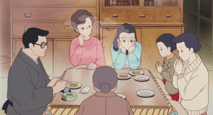 Taeko sitting around a kotatsu with her mother, father, sister and grandmother