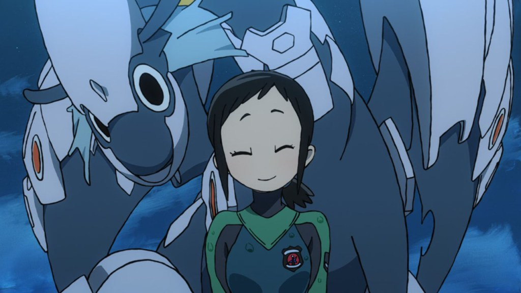 Hisone, dressed in her flight suit, stands in front of Masotan and smiles