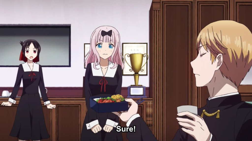 Chika smiling sweetly while Kaguya looks shocked and Shirogane looks smug