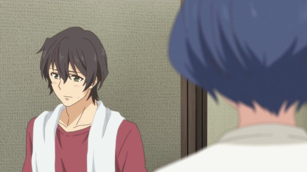 Natsuo with a towel around his neck, looking away from Rui