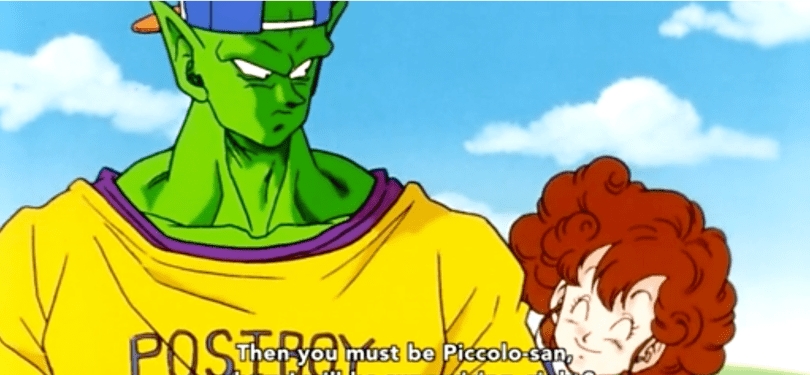 Piccolo from DBZ in a shirt and backwards baseball cap, a smiling woman beside him. subtitle: Then you must be Piccolo-san