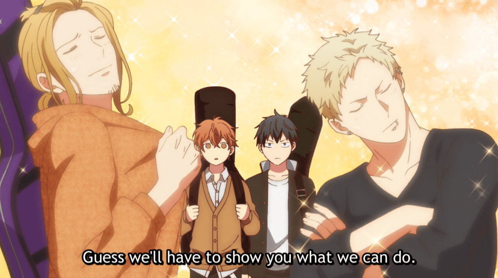 """Two young men pose with sparkles, trying to look cool, while two teen boys holding guitars stand puzzled behind them. Subtitles read """"Guess we'll have to show you what we can do."""""""