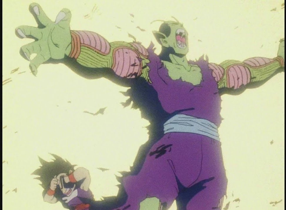 Piccolo shielding Gohan from an attack