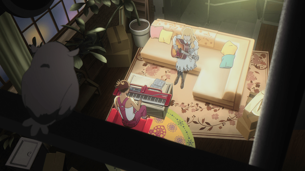 A high-angle shot of Carole and Tuesday in Carole's apartment. Carole is playing a keyboard; Tuesday is playing a guitar.