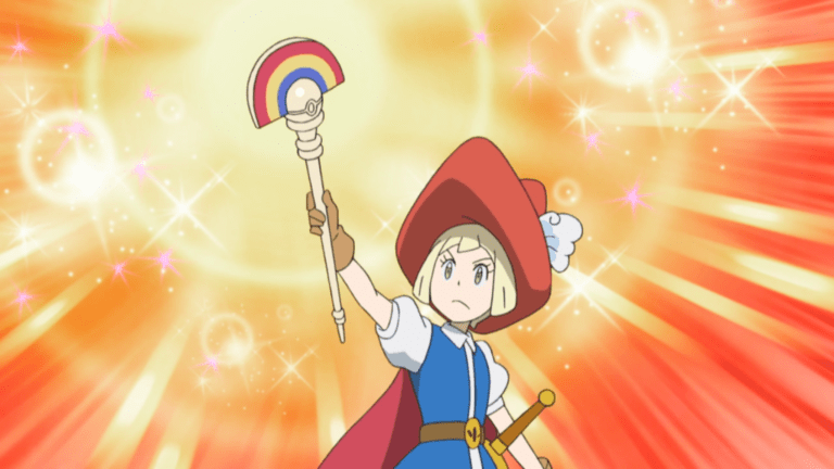 Lillie from Pokemon Sun & Moon wears a princely outfit and holds aloft a staff with a rainbow on the end. Sparkles burst out behind her.