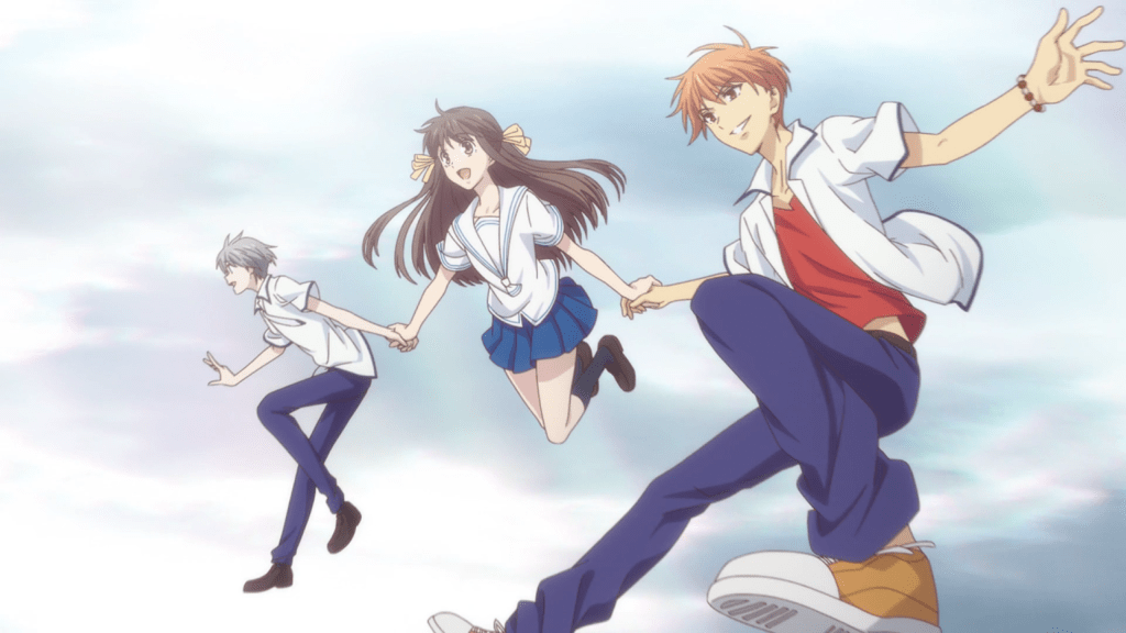 Tohru holds Kyo and Yuki's hands as the three jump in the air together, smiling.