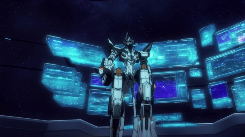 A mecha stands in front of a series of video screens.