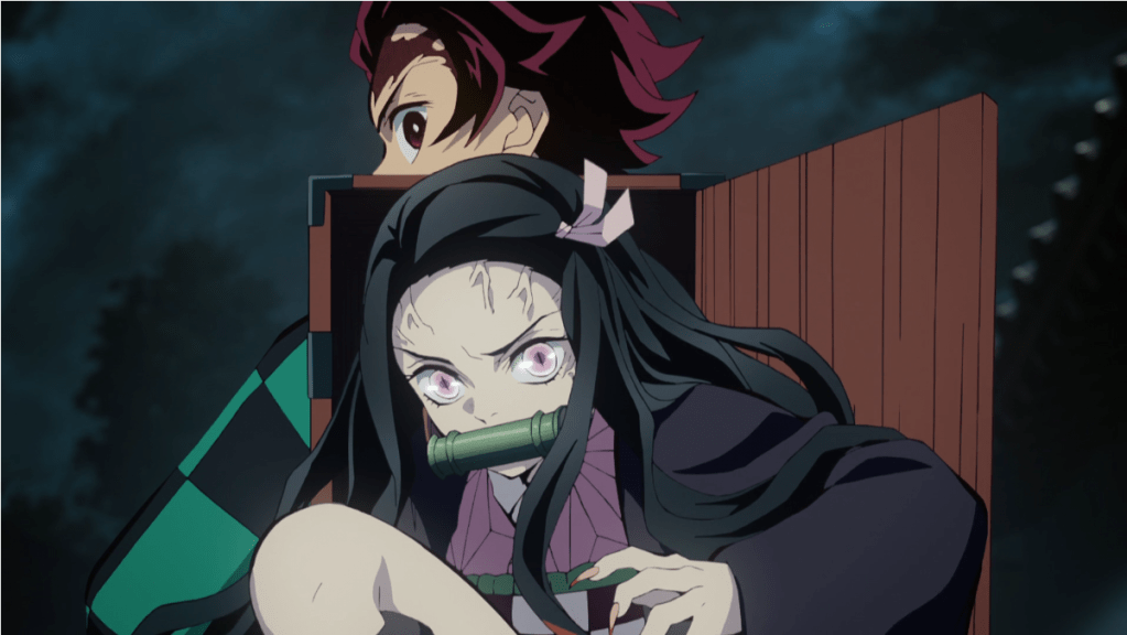 Nezuko coming out of the box on Tanjiro's back