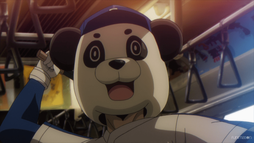 A man in a panda mascot outfit holds a knife