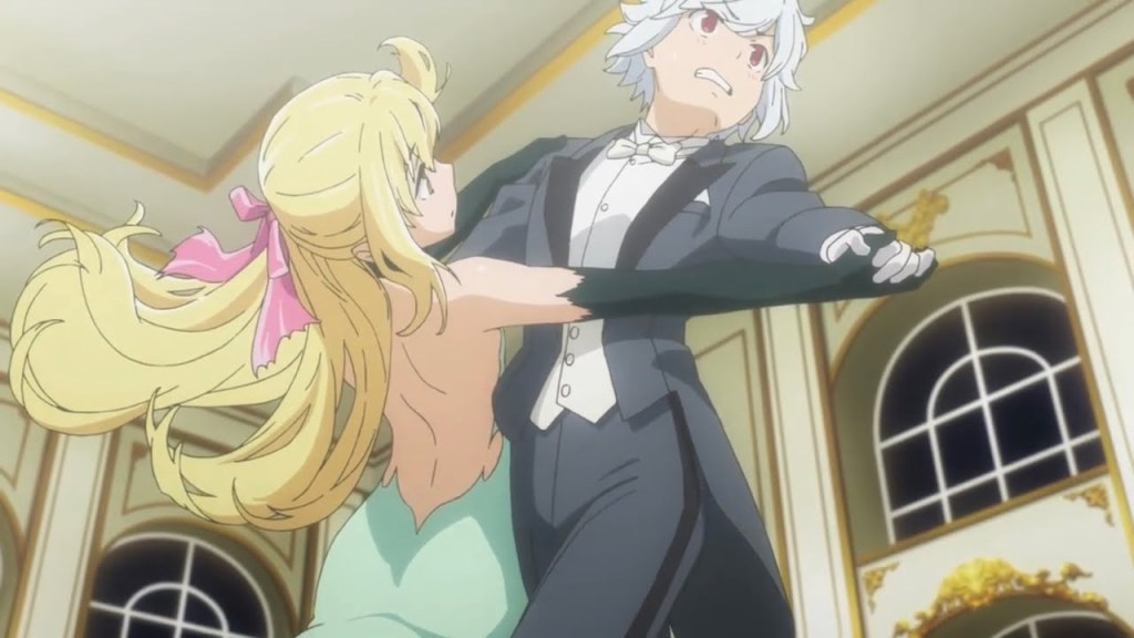 Bell dances with a blonde girl. Both are in evening wear and look nervous.