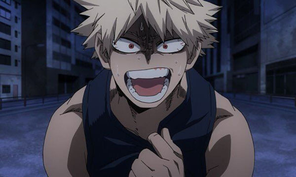 A frantic Bakugo standing in a street, gripping his shirt in one hand.