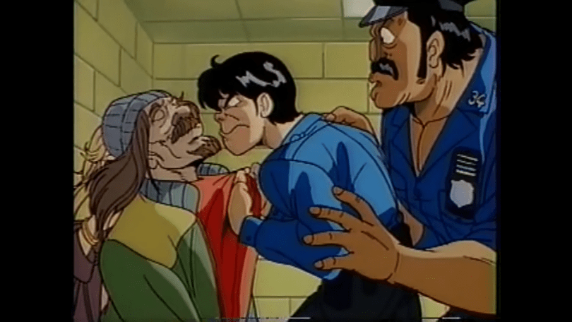 A cop (Daizaburo) holds an unkempt looking man by the shirt collar. A bigger cop (Sleepy) holds his angry partner back.