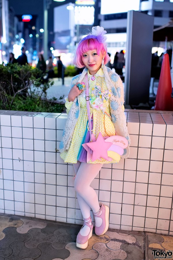 Pink haired woman in pastel posing for a photo