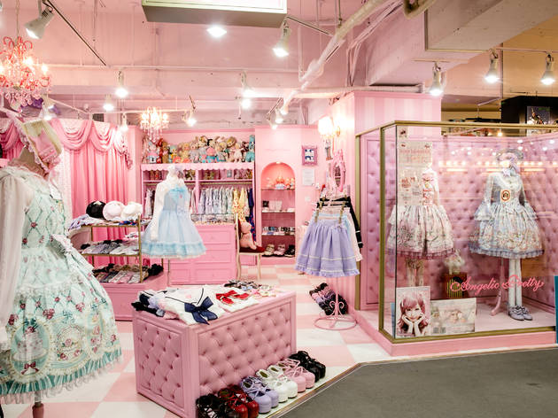 a pink storefront full of dresses