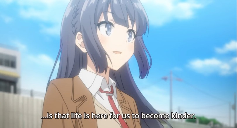 "A young woman looking hopefully towards the sky. Subtitle text: ""...is that life is here for us to become kinder."""