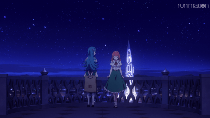 Two girls looking out over the city at night, one turned away and leaning against the railing