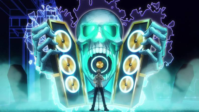 A man stands before a massive stereo with a giant, eerily glowing green skull between the speakers.