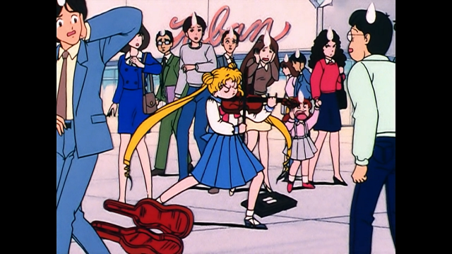 Usagi from Sailor Moon passionately playing the violin while onlookers look dismayed
