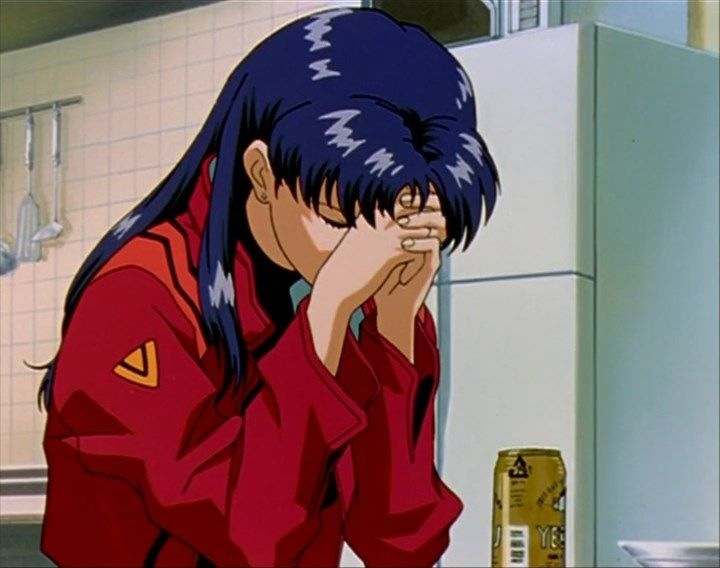 Misato seated with her head resting against her clasped hands