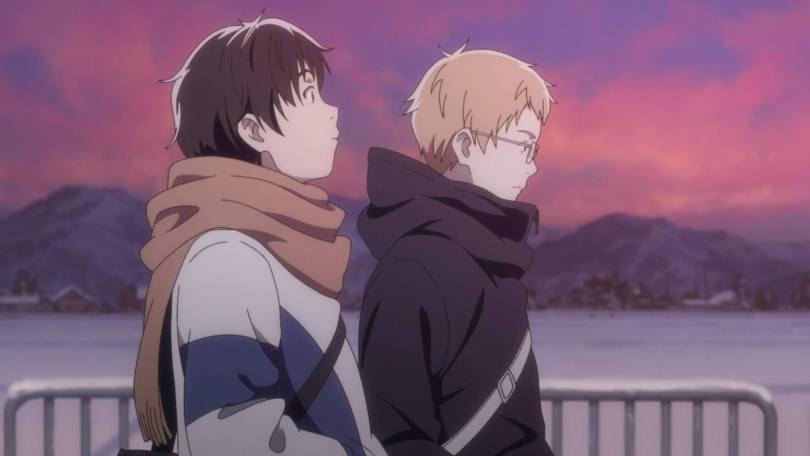 Yuni and Chika, wearing winter coats, walk side-by-side in front of a snowy, sunset-streaked landscape. Yuni is watching Chika curiously.