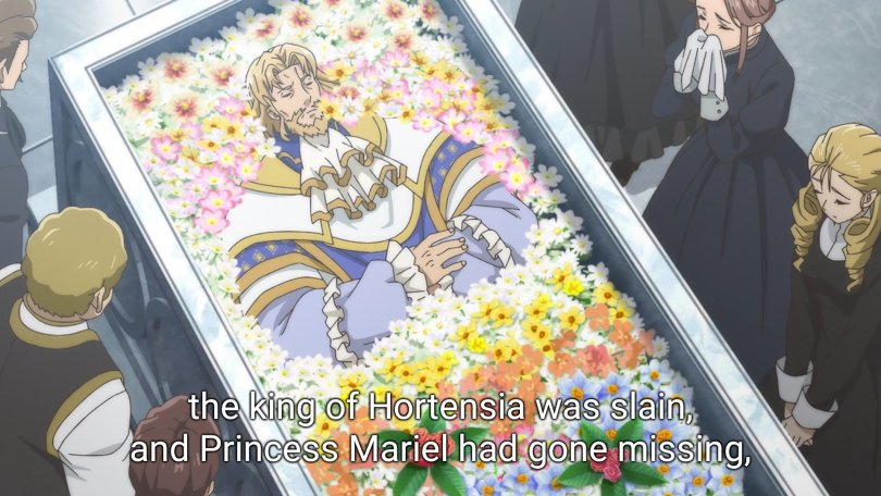 The king of Hortensia, deceased, lies in a coffin full of flowers as mourners surround him.