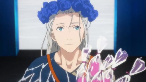 Young Victor wearing a flower corwn and holding a bouquet