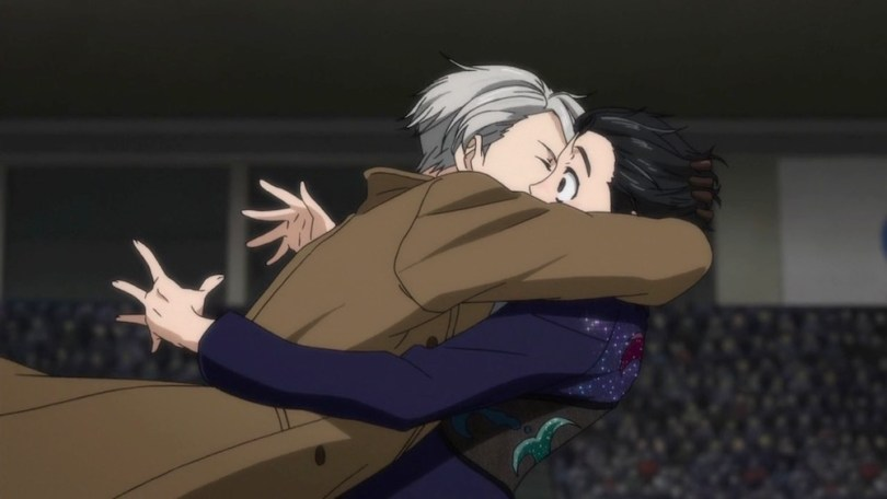 Victor leaping into Yuri's arms and kissing him