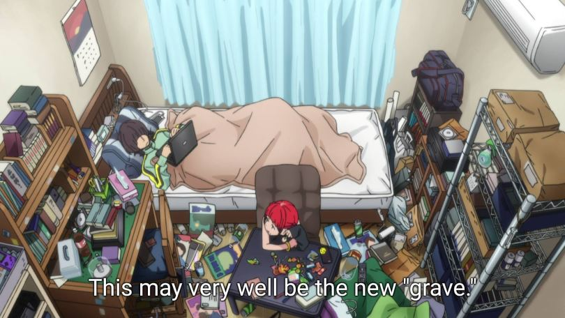 """Komori and Chise laze about in a small room filled with clutter and trash. Subtitles read """"This may very well be the new 'grave.'"""""""