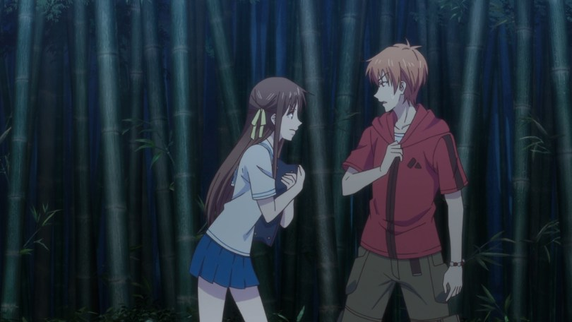 Tohru and Kyo in a bamboo thicket. Tohru is leaning toward Kyo with an intense expression, and Kyo looks taken aback