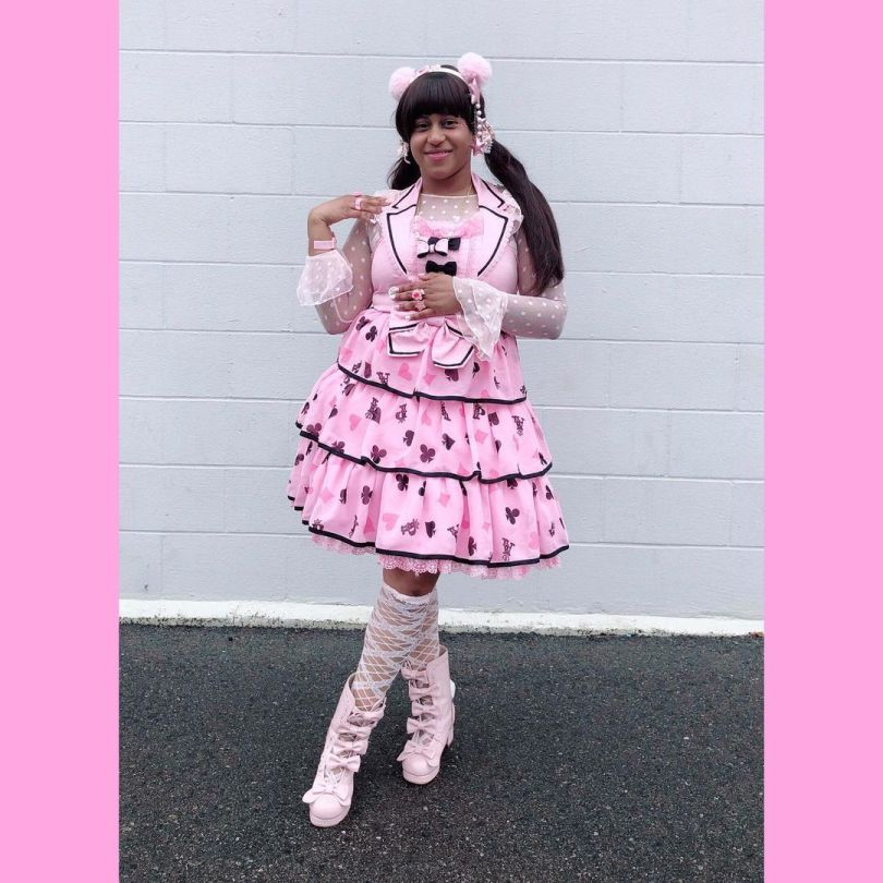 Marina Kei in an all-pink frill ensemble with pigtails