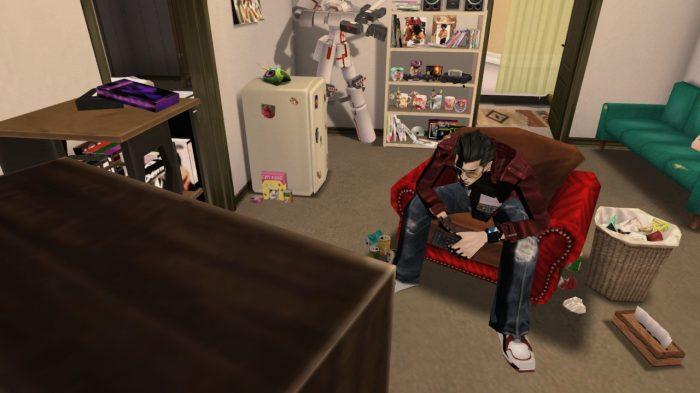 Travis playing video games in his apartment full of anime merch