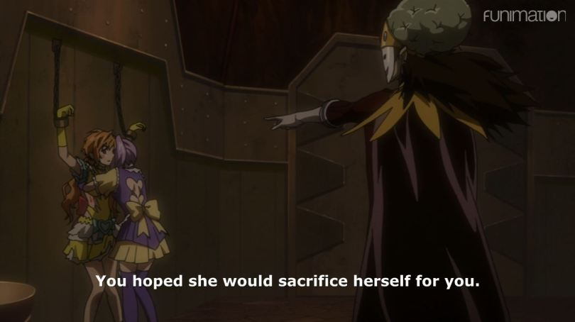 King torture pointing accusingly at Mari. subtitle: You hoped she would sacrifice herself for you.