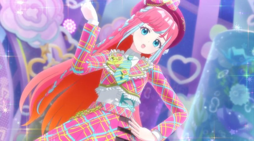 A girl in a sparkly plaid idol outfit, dancing against a rainbow glittery background