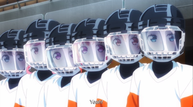A row of girls in ice hockey gear