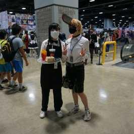 Photo of Denji and Reze, dressed as waiters