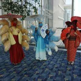 Photo of a cosplayer at Otakon 2021 dressed as three Kitsune