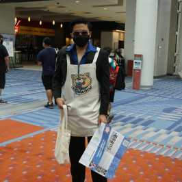 Photo of a cosplayer at Otakon 2021 dressed as Tatsu from Way of the Househusband